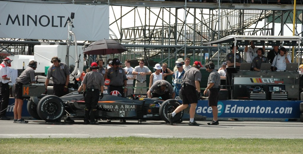 Race Car Engineers and Team on Track